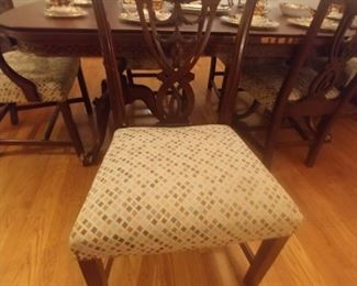 One of a set of six Chippendale style chairs