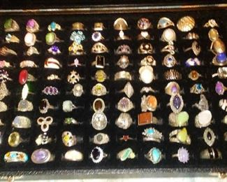 Collection of sterling silver rings with mounted semi precious stones