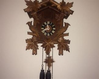 antique cuckoo clock - 24 hour type - keeps time