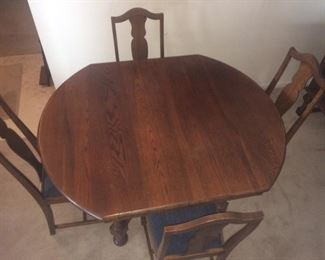 antique oak table (SOLD) - shown with 4 chairs, there is a leaf and 2 more chairs (CHAIRS STILL AVAILABLE)