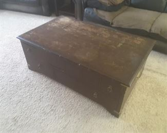 A  weathered coffee table with great storage.