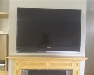 "A 52"" Mitsubishi Four Diamond flat screen TV on a control arm that allows for easy screen repositioning."
