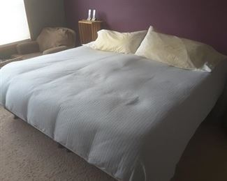 A Select Comfort brand king-size bed.
