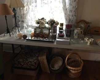 Many household items: lamps, candles, vases, baskets, frames, etc