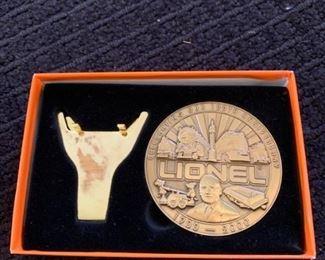 Lionel centennial coin # 1 https://ctbids.com/#!/description/share/293089