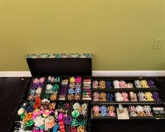Assorted wrapping paper, tissue, and bows https://ctbids.com/#!/description/share/293084