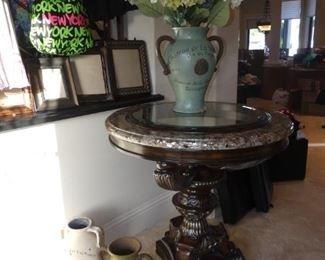 Pedestal Table with Floral Arrangements and Decorative Pots