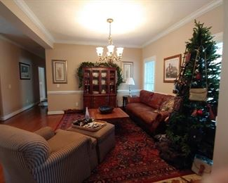 Baker Chair and Ottoman. Structure good condition. Upholstery is thin on arms. Leather Couch. Christmas tree with assorted designer bags.