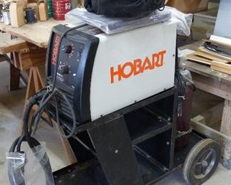 Hobart Mig Welder, cart, helmet, regulator, wire welding pliers, organ gas, & regulator