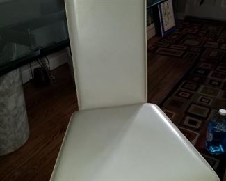 4 white leather chairs that go with the table