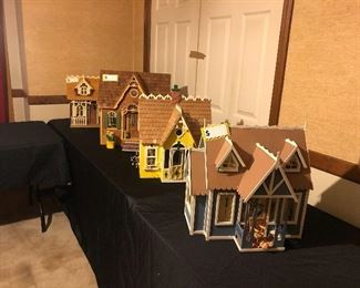 These dollhouses are all wood, fully furnished. Lots of detail and time was spent on these. You must see!