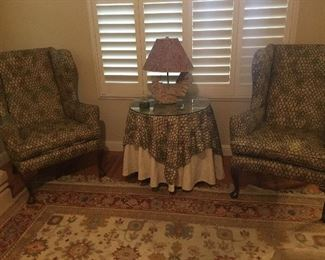A pair of Wing Back Chairs, Oriental Rug.