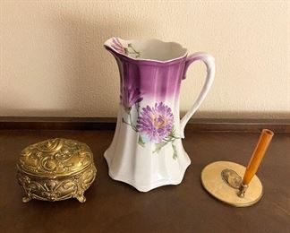 Dresser trinket box, E.L.P.  Co. antique pitcher, and a celluloid pen holder with mirror.
