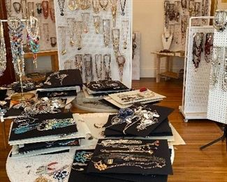 This is one of over a dozen large areas covered with jewelry and accessories, as well as all the fixings to make and manufacture jewelry.