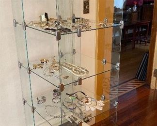 There are cases, racks and hundreds of jewelry accessories also