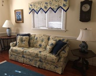Sleeper sofa, lamp tables and area rug