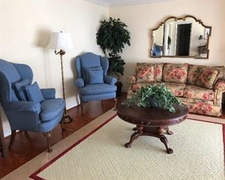 Wing back chairs, sofa, floor lamps and round coffee table