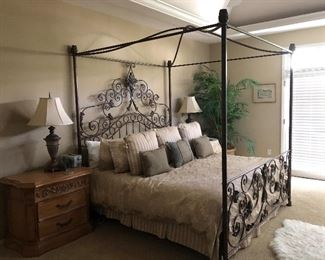 Iron Canopy bed with ornate headboard