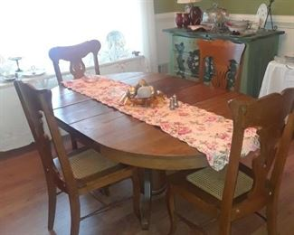 Oval dining table, oak, with four chairs, circa 1900