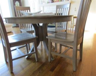 I love this table it's a creamy beige with 4 chairs. Thisnk Kitchen or Game Table