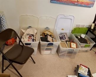 have a seat and look through 4 tubs of picture frames