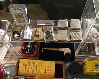 TABLE LIGHTERS, ST DUPONT, ZIPPOS, MILITARY LIGHTERS AND MORE.