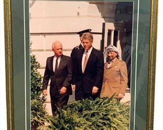 "Clinton and Arafat Peace talk photograph, framed Clinton and Arafat Peace talk photograph, framed 15x19"" All art catalogued dimensions are shown as framed. Provenance: Private Collection of Mark E. Talisman"