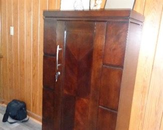 front of the locking bar/liquor cabinet