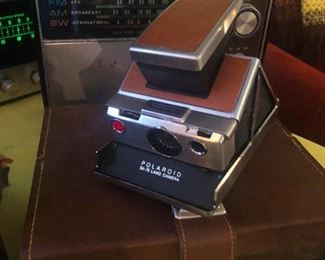 Vintage polaroid camera and other cameras