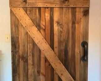 Beautiful handmade wooden barn door.  Great for so many areas in your home. You may have a livingroom entry or even a bathroom door that you want a sliding door. This just adds that special feeling to a home like no other.