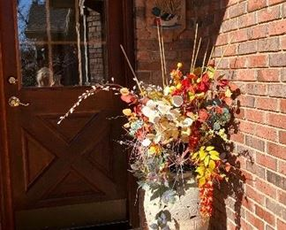 Large pottery vase and silk flowers