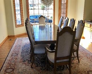 Large Pecan dining table wit 2 leafs and 8 upholster  chairs. Beautiful 9 x 12 wool rug