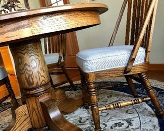 Round oak table, side view of chairs...very nice!