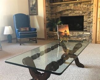 Glass top coffee table, blue wing back chair (Ethan Allen)