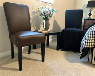 Brown chair and same chair with slip cover, (two chairs, two slip covers) small table, vase with flowers