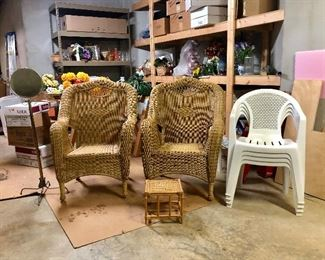 Two wicker chairs and 4 plastic chairs