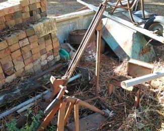 Scrap iron and wheel barrow in the back yard