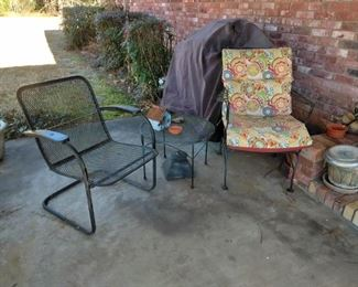metal patio chairs and side tables,