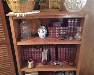 Book cases, collectible books and shelf sitters