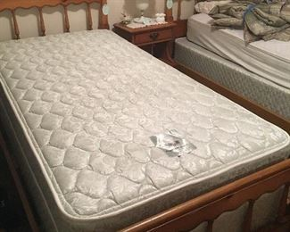 Two Thomasville two beds with mattresses and nightstand