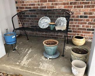 Several pots/wrought iron bence