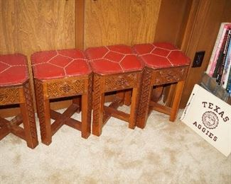 small red leather top, carved wood stools