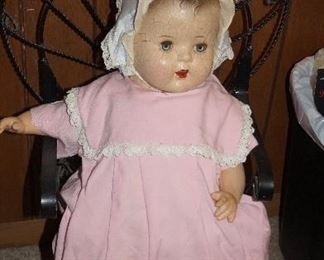 Vintage doll in chair
