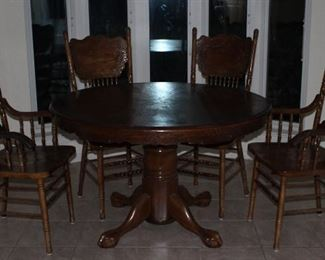 "Oak Clawfoot Pedestal Base 48"" Round Table w/24"" Leaf (expands to 72"" x 48"" Oval Table) and 2 Arm Chairs and 2 Side Chairs"