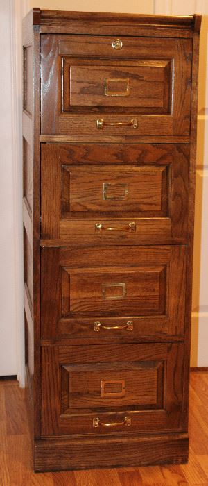 "Oak Legal Size 4-Drawer Vertical  Filing Cabinet. 1 of 2 Shown. (18 3/4""W x 25""D x 53 1/2""H)"
