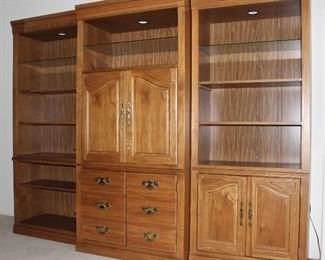"Golden Oak 3-piece Sectional Entertainment Cabinet/Bookcase/Curio.  Side sections: 32"" W x 78""H, center section 36"" W x 78""H."