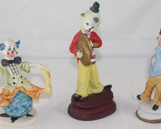 "Clown Figurines:  Depose Italy ""On Top of the World ""  (5.5""), Clown with Cymbals Bisque Porcelain and McCrory Corp Bisque Clown with Umbrella."