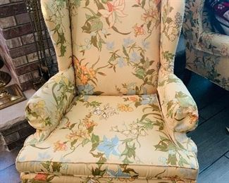 one of two upholstered wing back chairs
