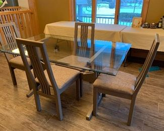 dining room glass top trestle table with chairs