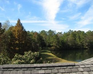 Looking from the upstairs balcony to the lake on the west side of the home
